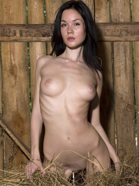 Lovely Marsha  plays naked in the hay