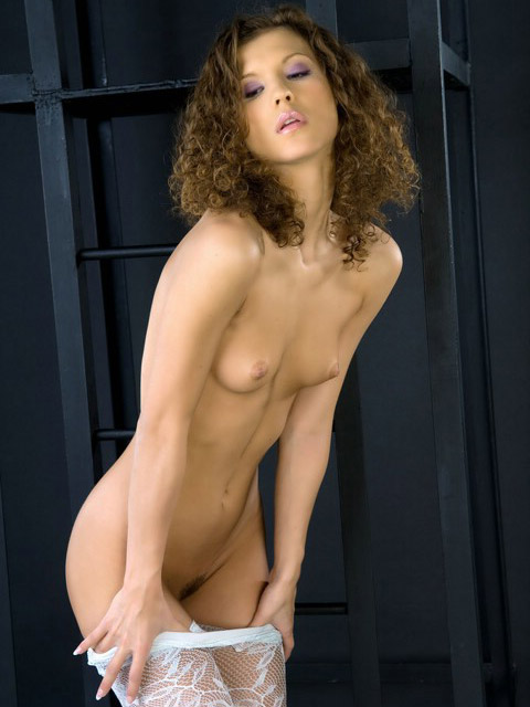 Seductive naked model with curly hair
